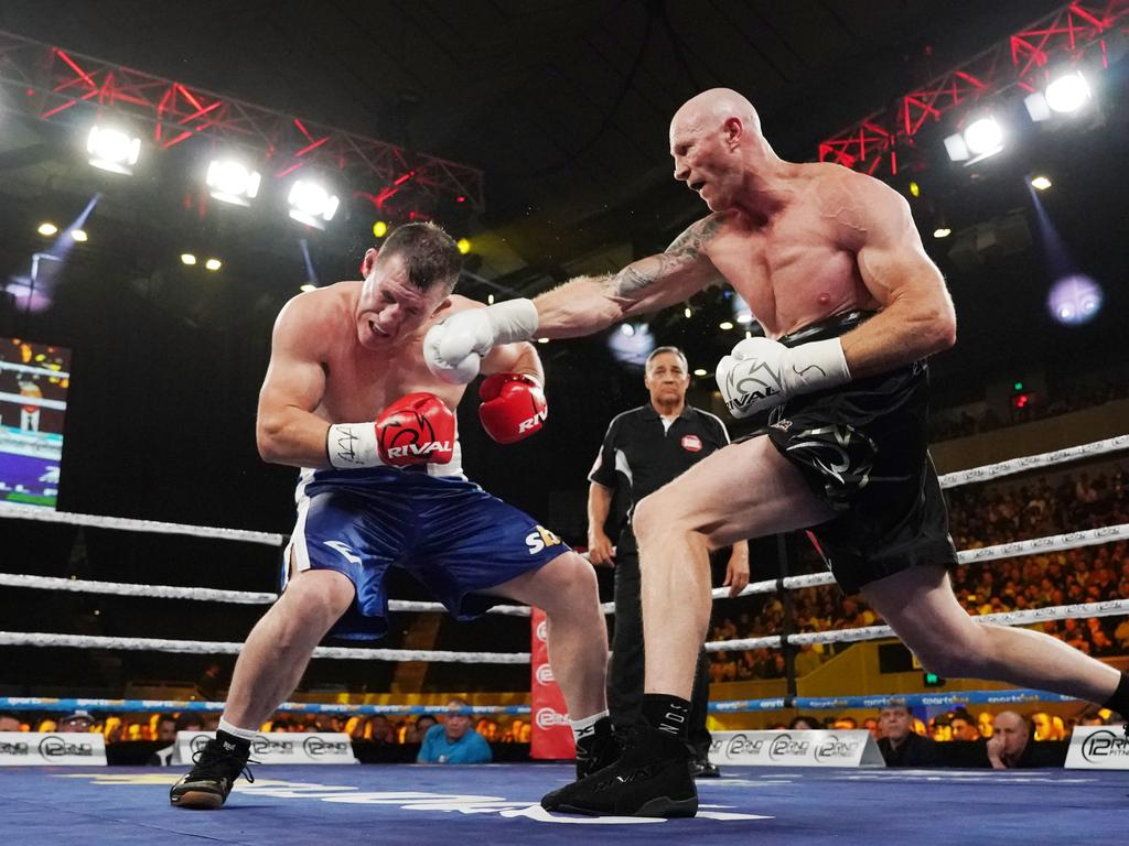 Barry Hall nails Paul Gallen during the Code War Boxing night at Margaret Court Arena in Melbourne. (AAP Image/Michael Dodge)