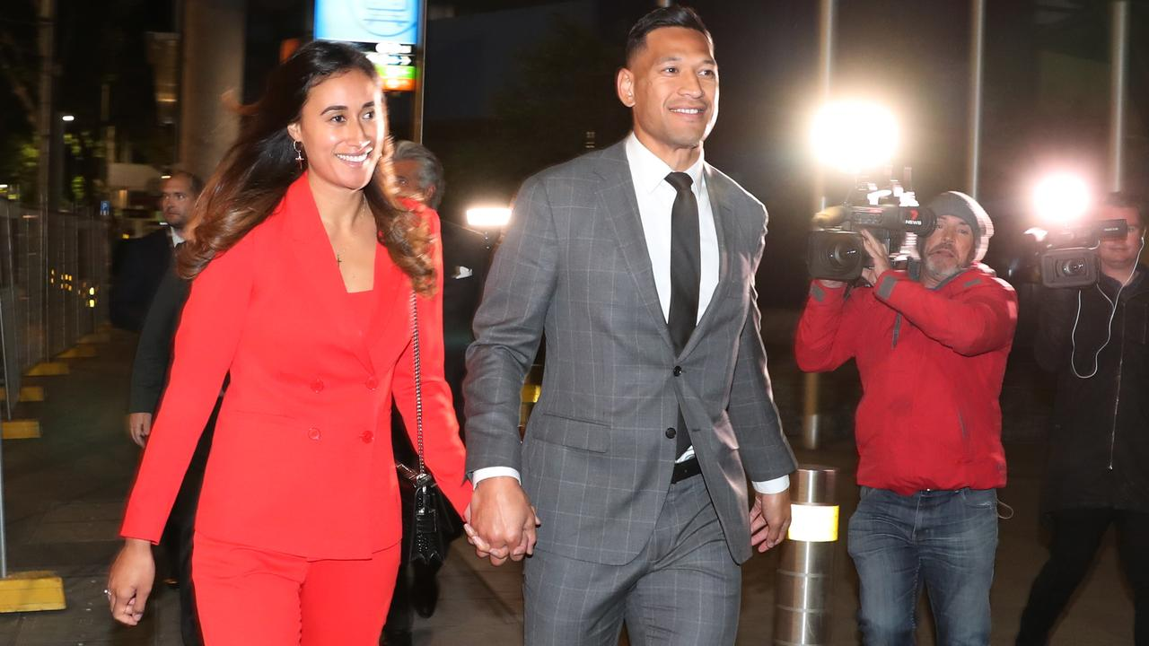 A beaming Maria and Israel Folau leave the Federal Circuit Court in Melbourne on Monday. Picture: AAP/David Crosling