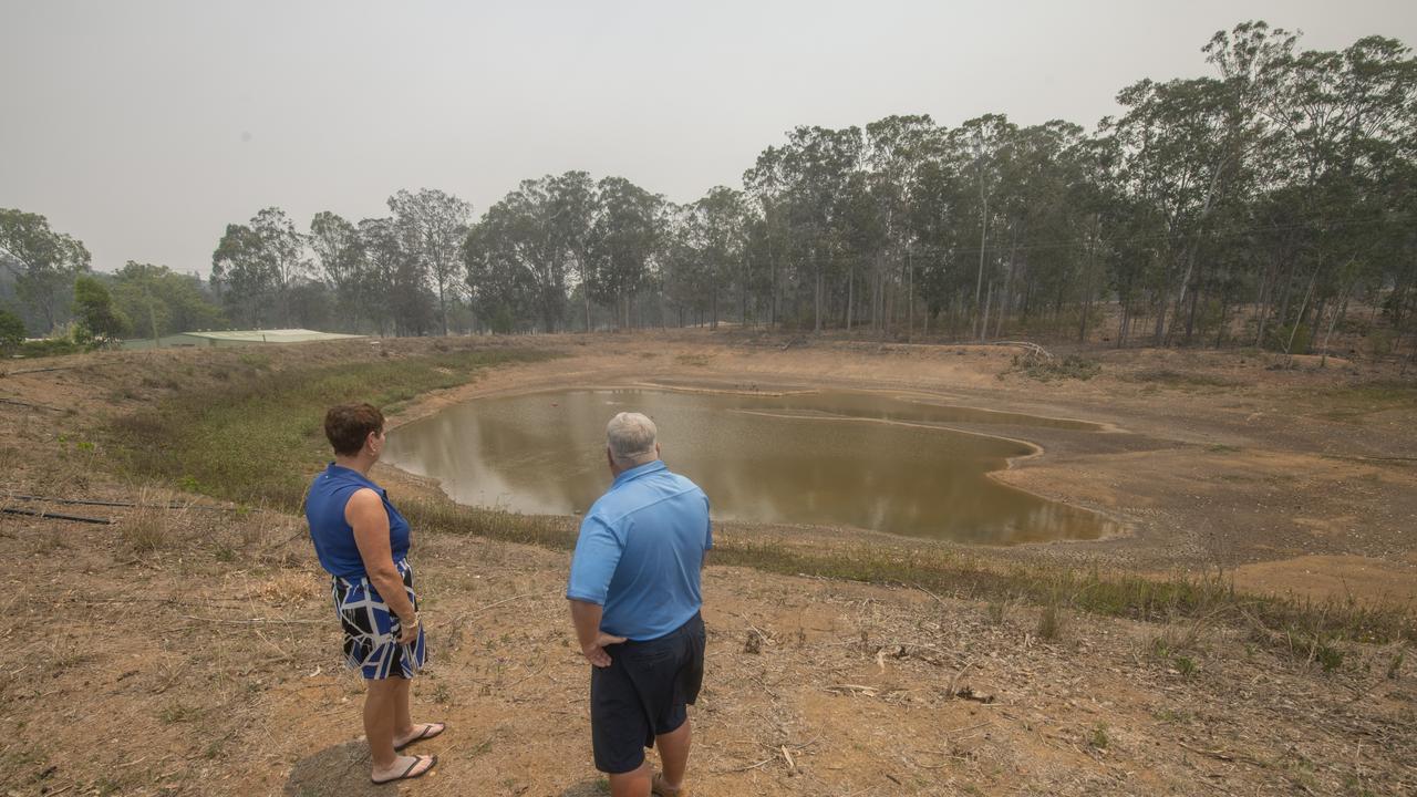 Grafton Golf Club ladies captain Janette Blair and club captain David Morgan look at the near empty dam at the course. Photo: Adam Hourigan