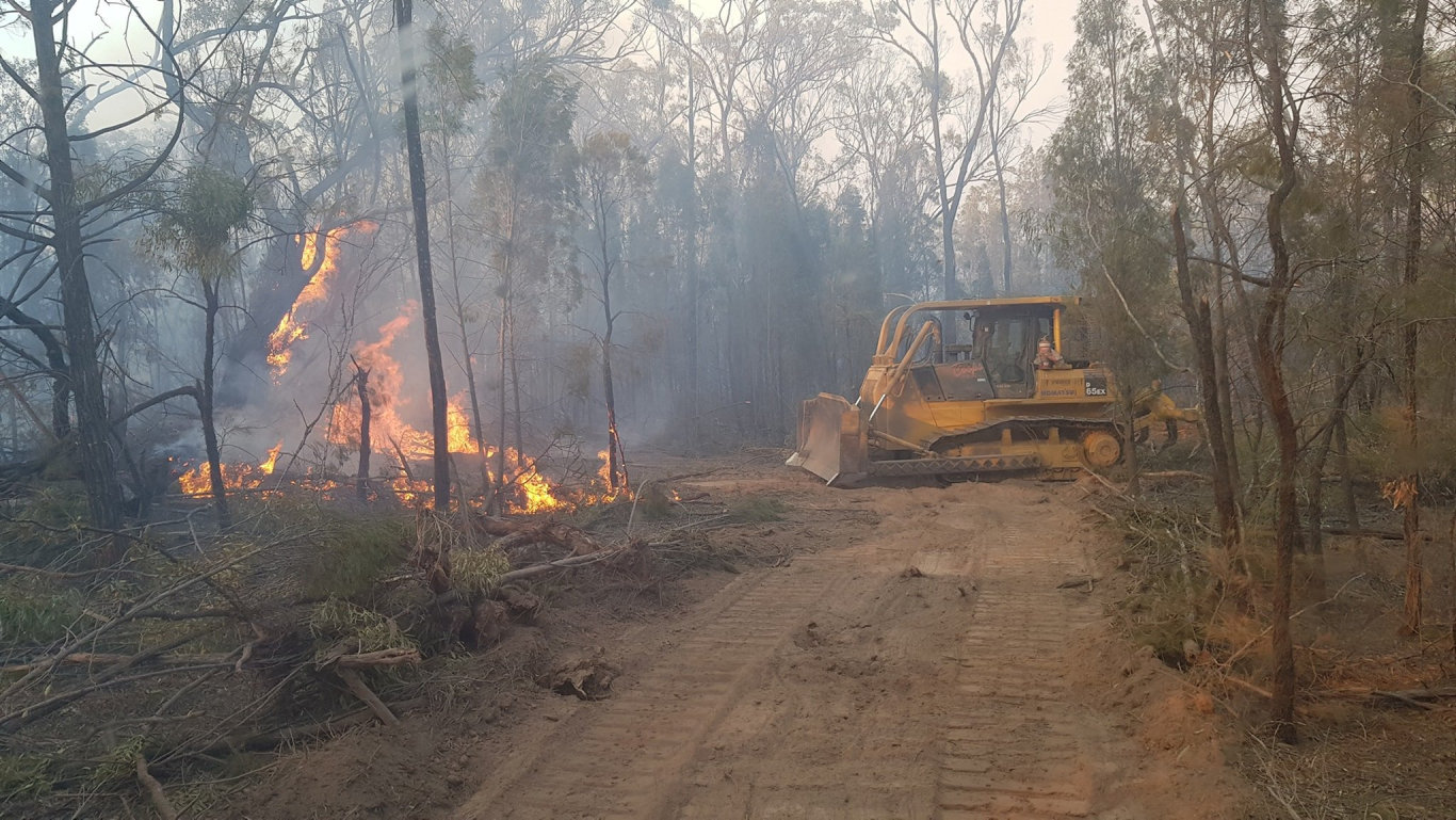 Cambooya Rural Fire Brigade voluntee\r Nathan Greer took these photos while fighting the Forest Ridge and Cypress Gardens fire, yesterday, December 4.