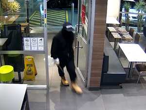 WATCH: Armed thief swings bat in McDonald's heist