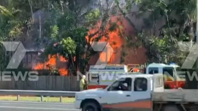 Raging fire engulfs two-storey home