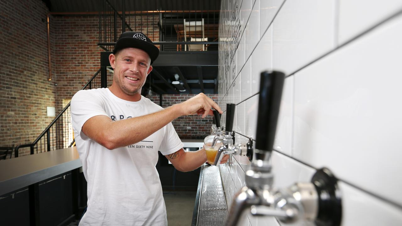 Mick Fanning pours a beer at his Balter brewery at Currumbin. Picture: NIGEL HALLETT