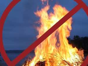 Man charged over lighting fire during total ban