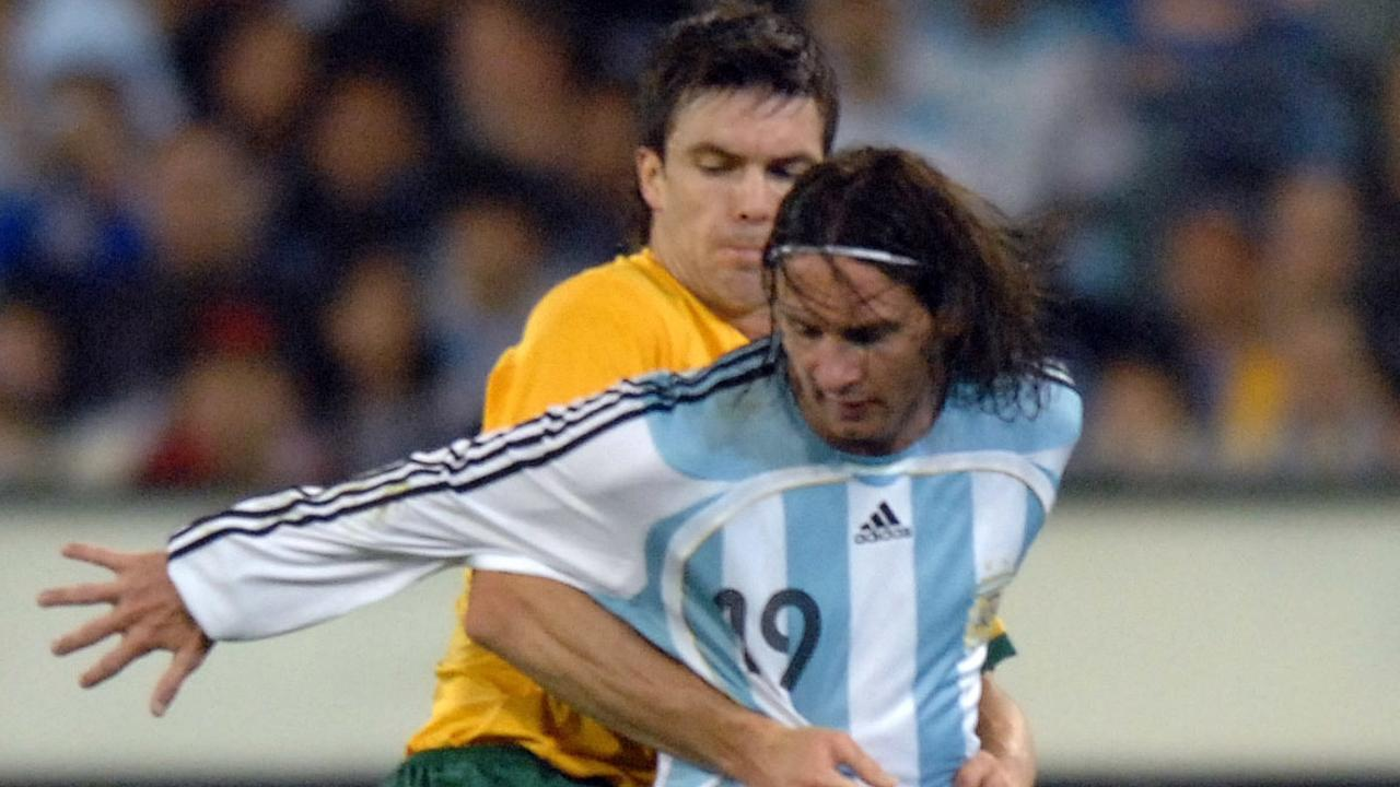 Socceroo Michael Beauchamp holds Argentine player Lionel Messi as Australia plays Argentina in an international friendly match at the MCG in Melbourne, Tuesday, Sept. 11, 2007. Argentina won 1-0. Photo: AAP