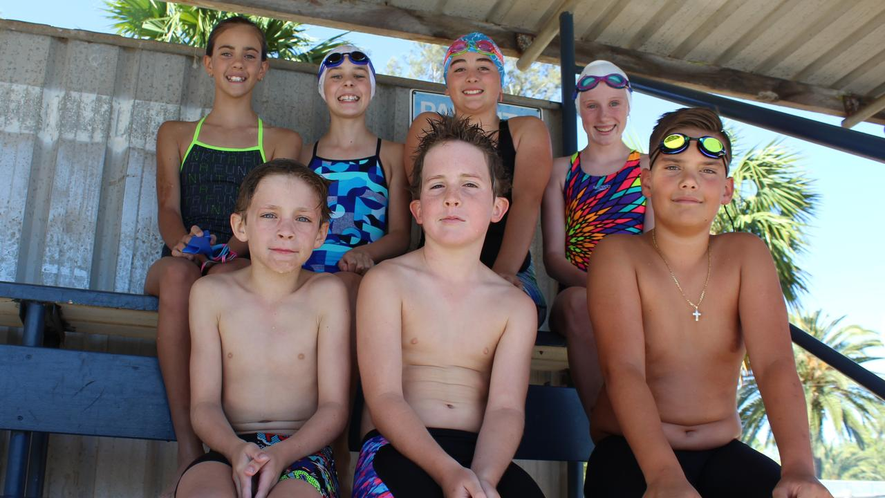 YOUNG GUNS: Caylee Crossingham, Casey Springhill, Sarah Adcock and Shanelle Zischke with Mitchell Zischke, Matty Reddacliff and Braith Crossingham who are excited to compete at the Gympie swimming carnival.