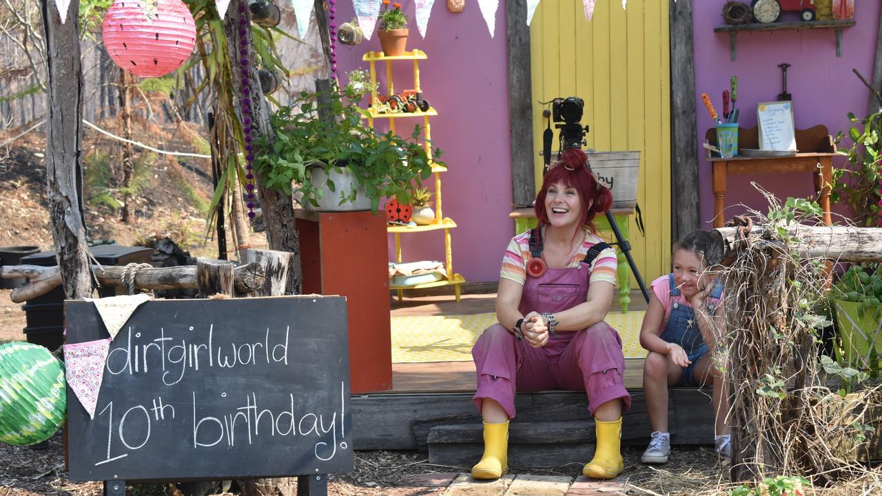 Dirtgirl with mini dirtgirl for the day, Danielle Hay, 7, celebrating the tenth birthday of Dirtgirl World at Camira Creek.