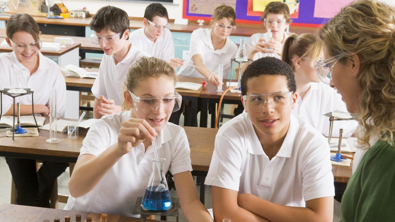 QST Enrolments generic schoolchildren conducting science experiment