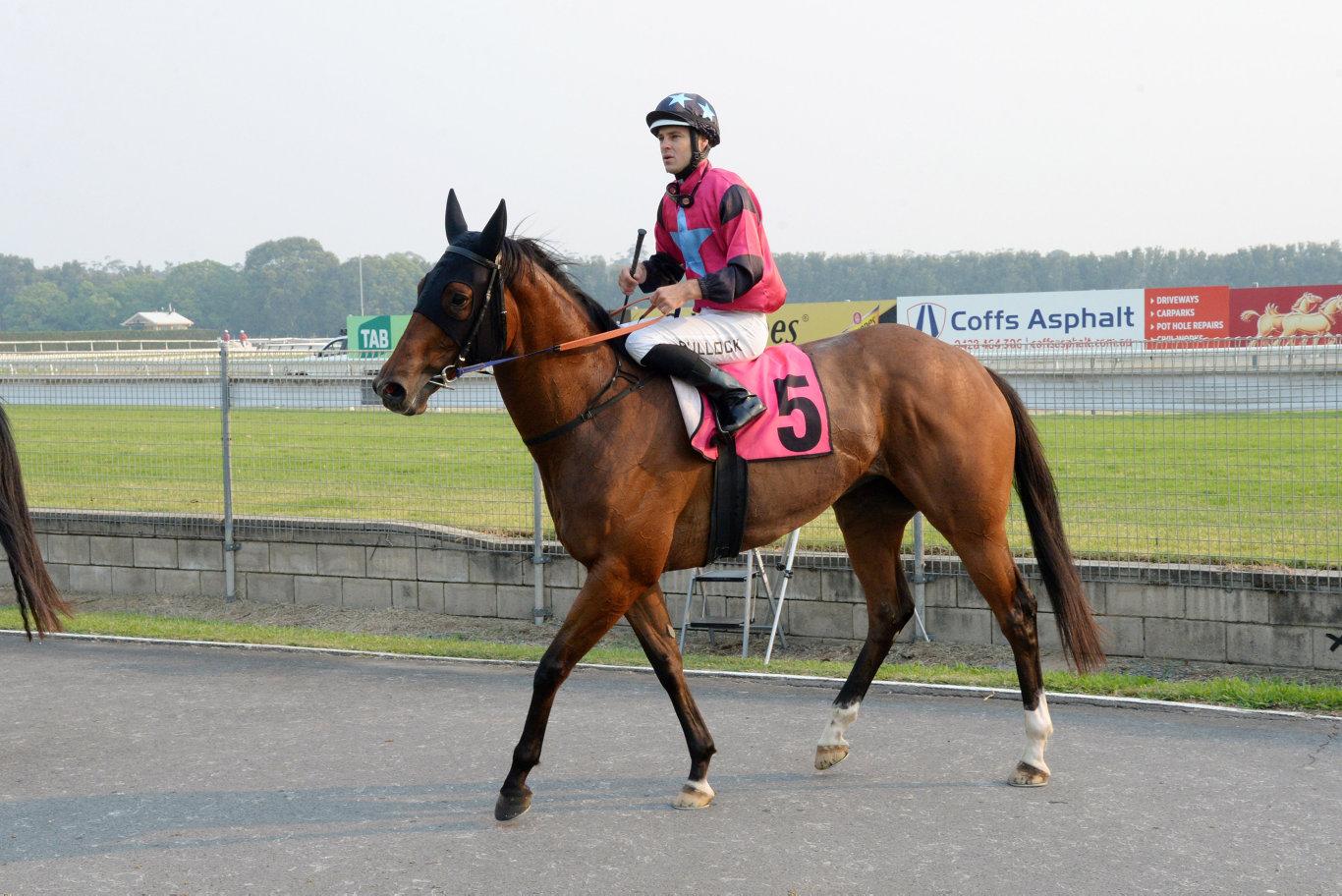 Jockey Aaron Bullock rides Alternative Facts back to the winners enclosure.