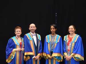 CQU PHD graduates Dr Cheryl Bookallil, Dr Adam Rose