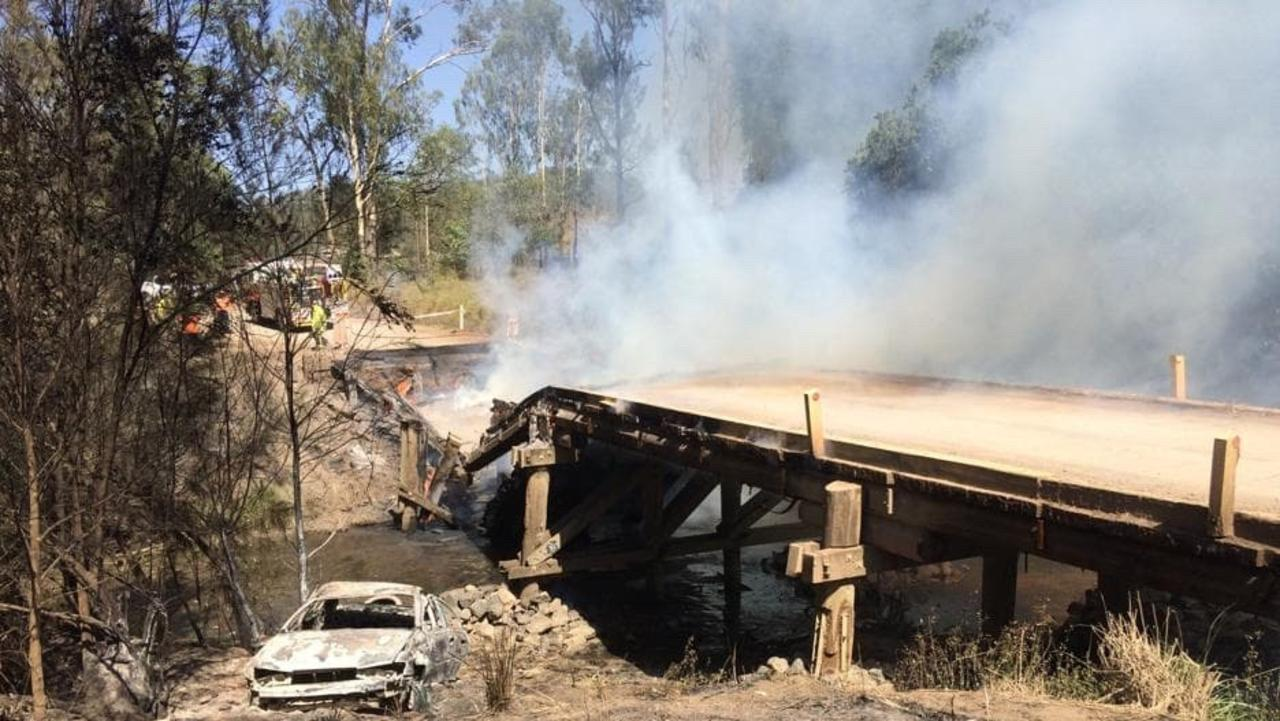 BRIDGE COLLAPSE: The Running Creek bridge on Brooweena-Woolooga Rd has now collapsed due to a fire overnight. The road is closed from the bridge. Photo: CONTRIBUTED