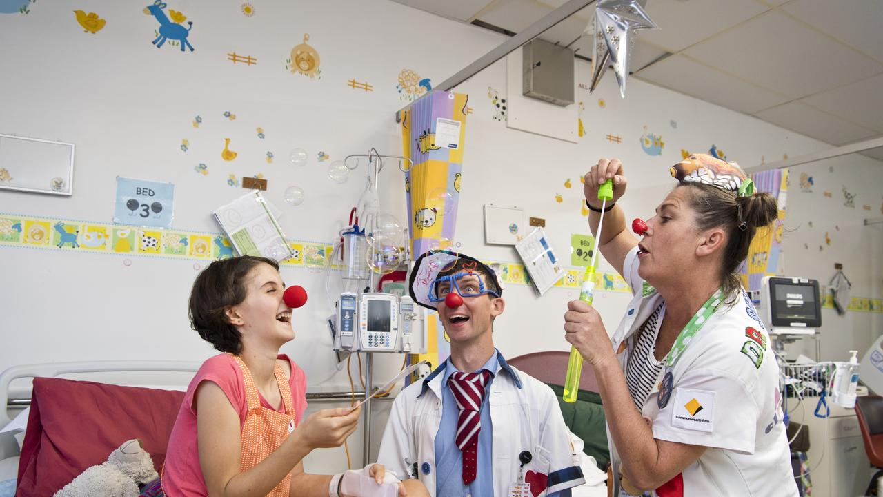 FUN AND GAMES: Toowoomba Hospital patient Eva Palmer joins in on the fun with Dr O'Dear (Robbie O'Brien) and Dr Sniggles (Helen Quinlan) as the Humour Foundation's clown doctors pay the ward a visit. Picture: Kevin Farmer