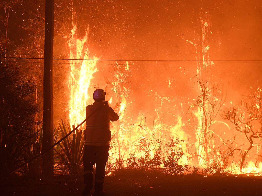 NSW Rural Fire Service crews work at the Three Mile Fire. Picture: AAP Image/Dan Himbrechts