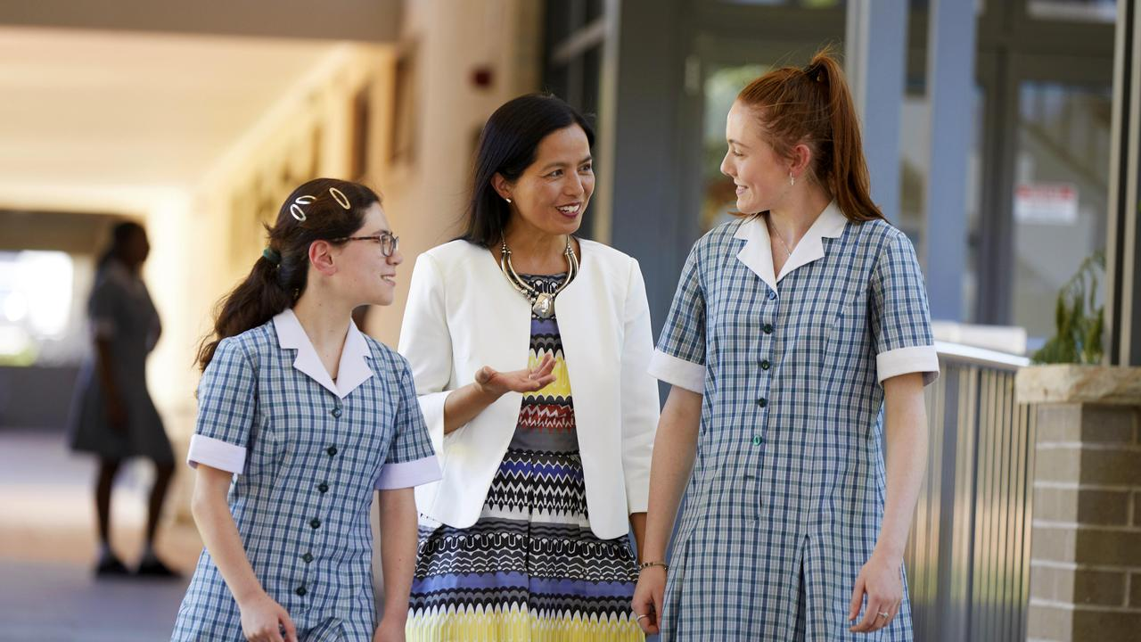 PENRITH PRESS/AAP. Mongrove College student Jini-Mary McDonald and Hannah Wilkinson pose for photographs with Principal Lourdes Mejia in Orchard Hills on Thursday 5 December, 2019. Montgrove college has been revealed as one of the highest performing schools in NAPLAN in western Sydney. (AAP IMAGE / Angelo Velardo)