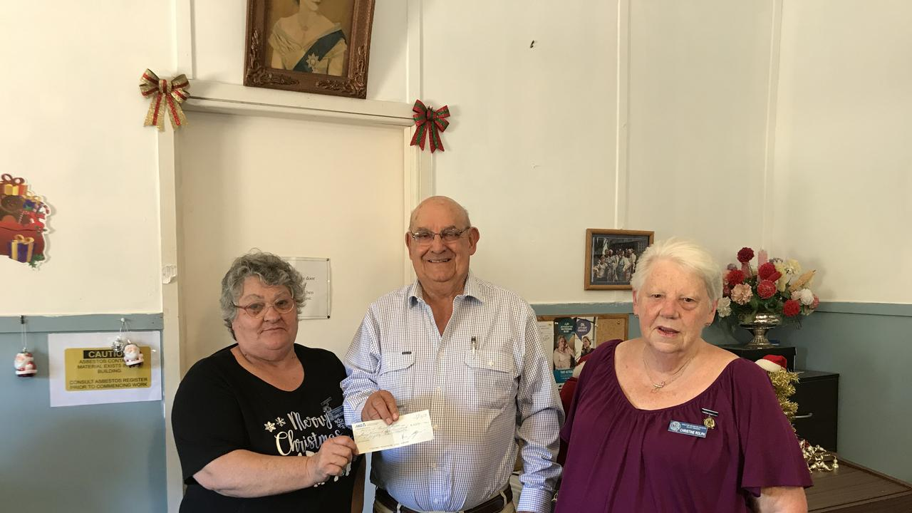 Kilcoy Race Club President Con Searle handing cheque for $1,689 to Caryl Cook and Christine King of the QCWA Kilcoy branch.