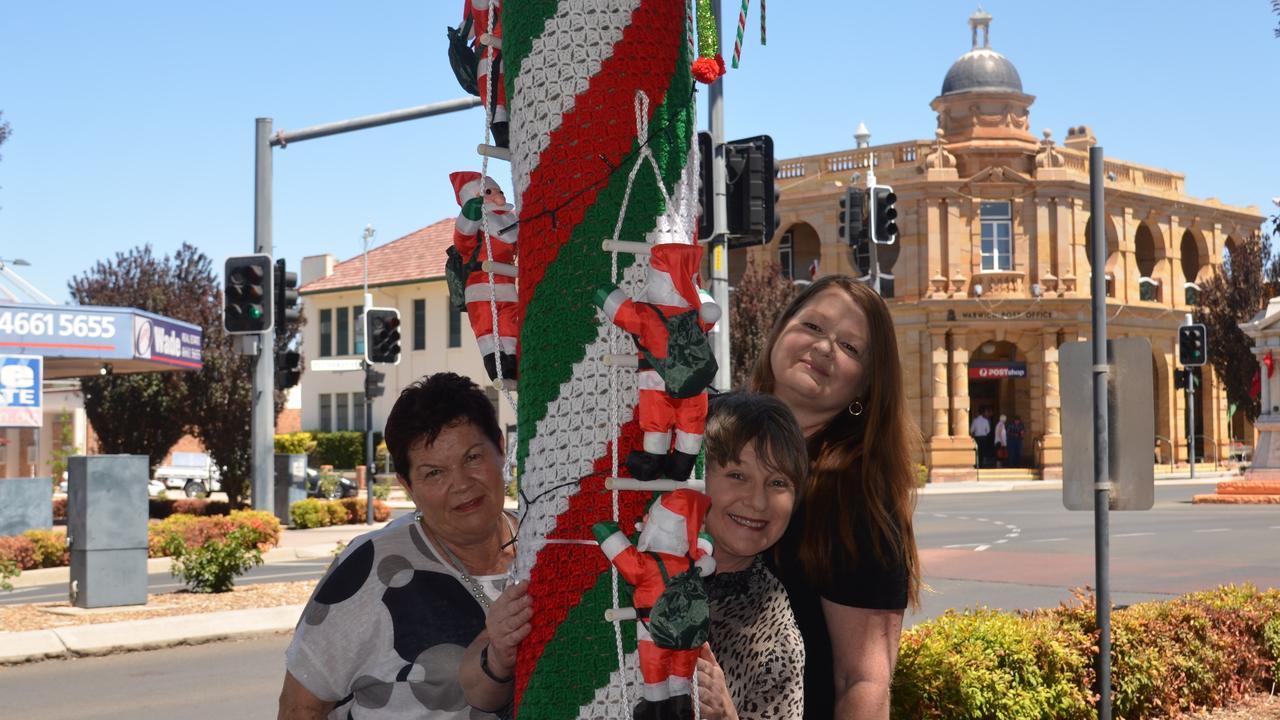 FESTIVE SPIRIT: Robyn Fraser, Kay Martin and Julia Keogh celebrate DownTown Christmas.