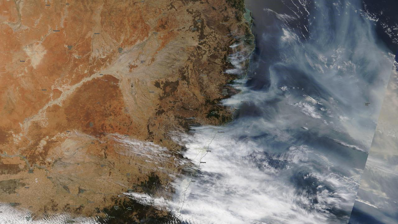 NASA images show bushfire smoke blowing from the NSW coast over the Pacific Ocean on December 6, 2019. Picture: NASA