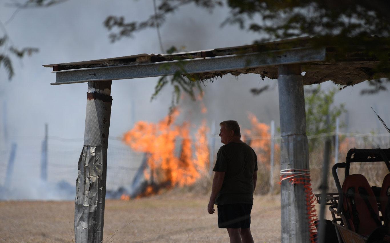 Fire crews battle a large grass blaze at Bundamba