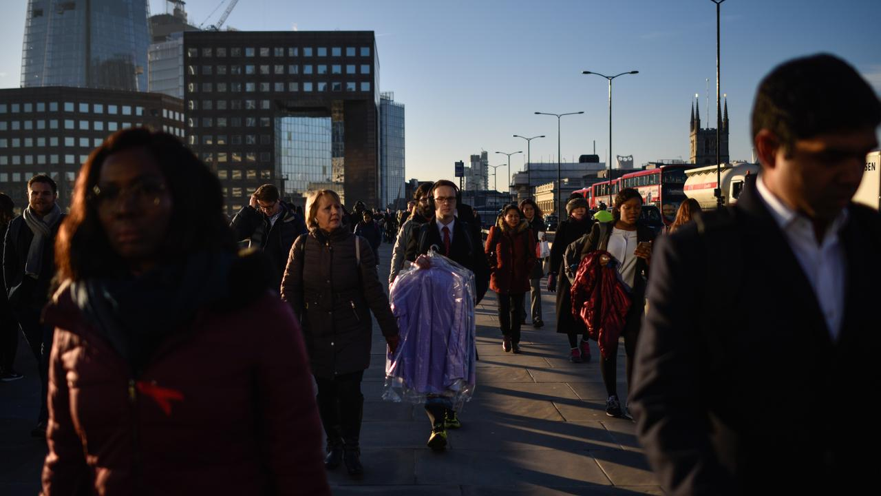 Commuters cross London Bridge, after it was reopened following the terror attack. Picture: Peter Summers/Getty Images