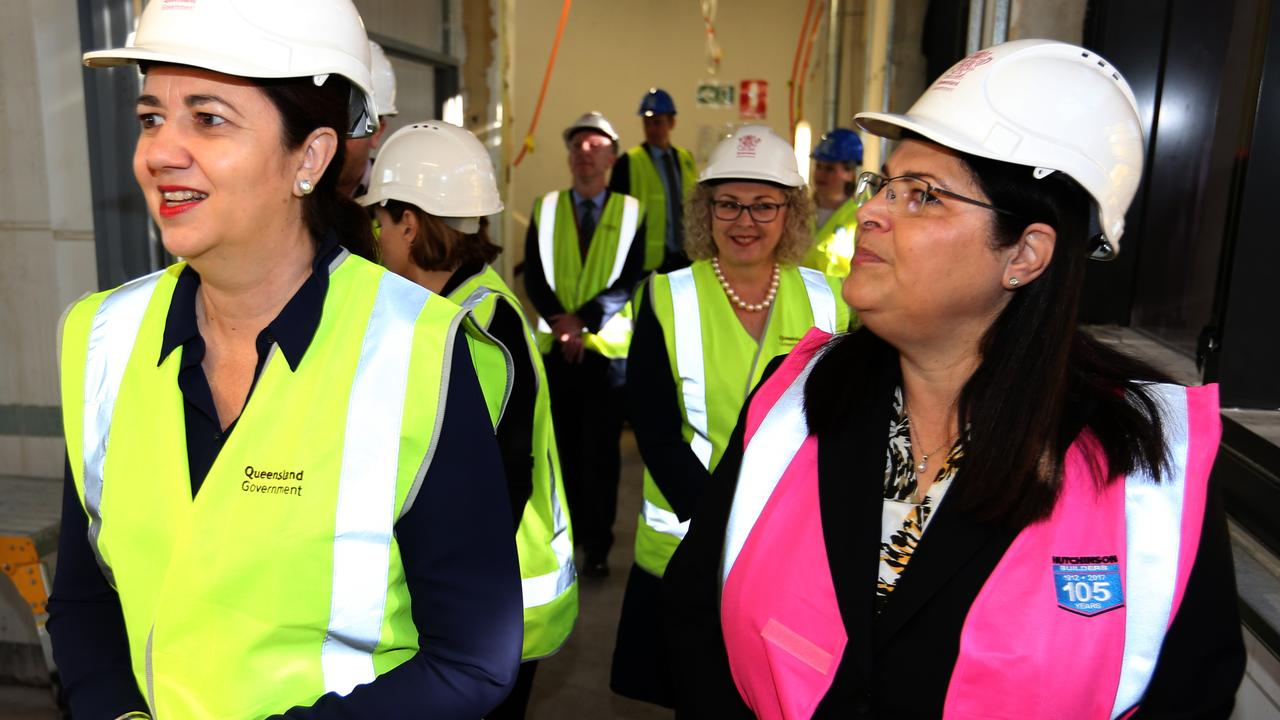 Premier Annastacia Palaszczuk and Education Minister Grace Grace inspect the construction on the new Fortitude Valley State Secondary College in June. Picture: AAP Image/Richard Waugh