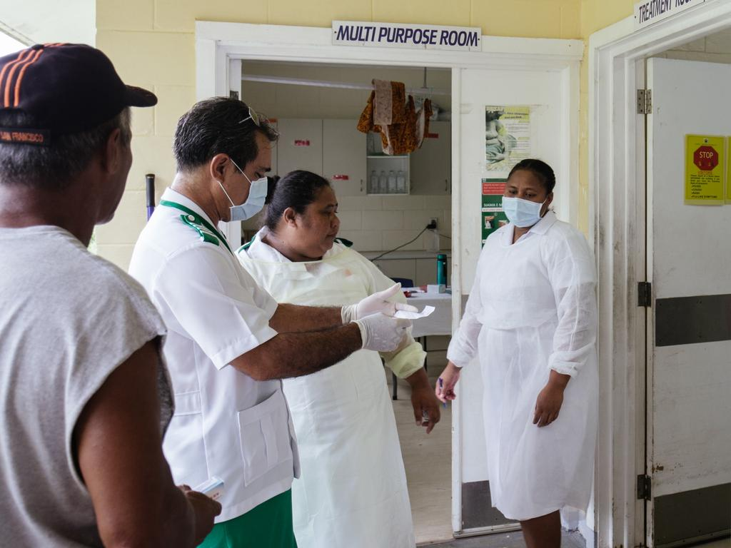 Poutasi District Nurse Manager James Belford verifies medical records with staff nurses. Picture: Infinity Images Fiji