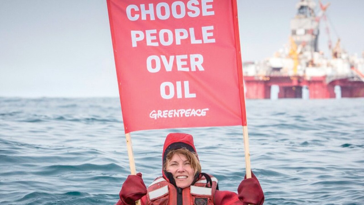 Actress Lucy Lawless protests for Greenpeace.