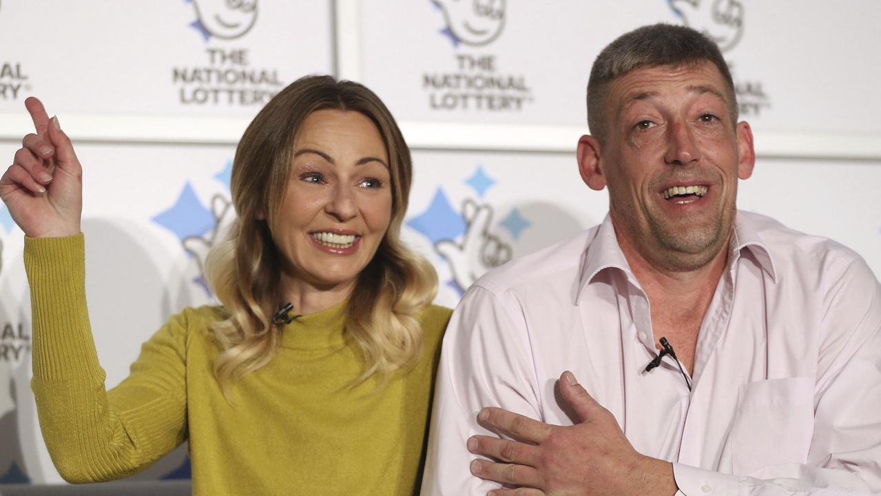 Self-employed builder Steve Thomson and his wife Lenka celebrated their $A201 million win in late November. Picture: Andrew Matthews/PA via AP
