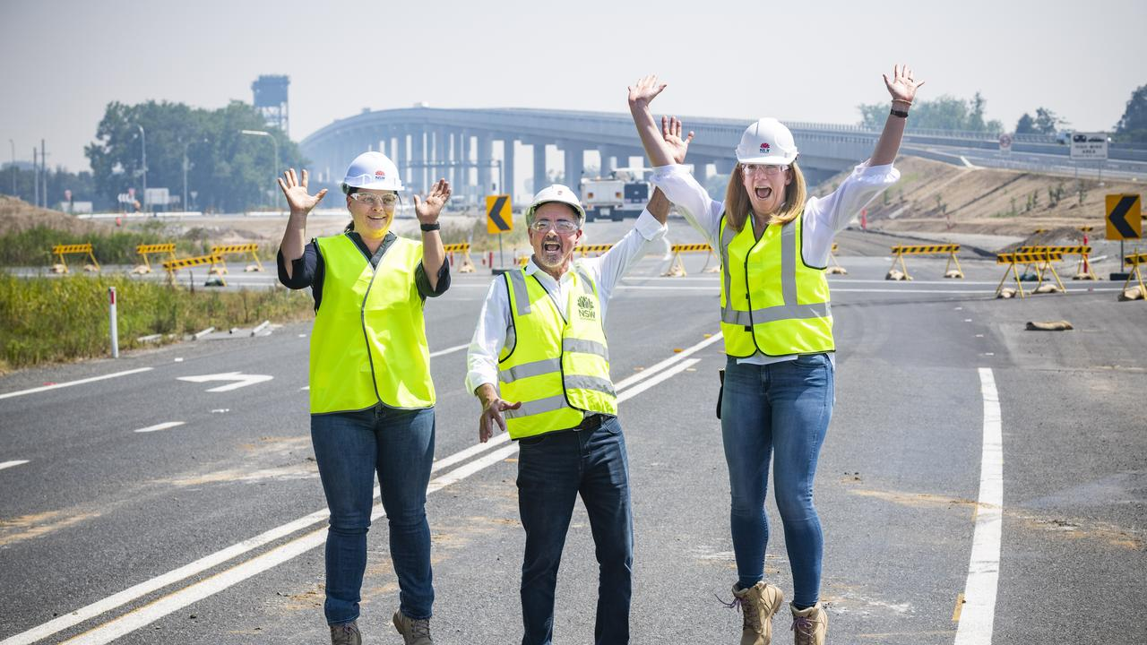 Transport for NSW project manager Yvonne Bowles, Member for Clarence Chris Gulaptis and Regional Director Northern from Transport for NSW regional director northern Anna Andrews give a jump for joy after seeing the new Harwood bridge open. Photo: Adam Hourigan