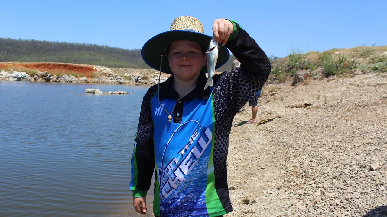YOUNG FISHERMAN: Samuel Weller with his latest catch before he released it back into BP Dam. Picture: Laura Blackmore