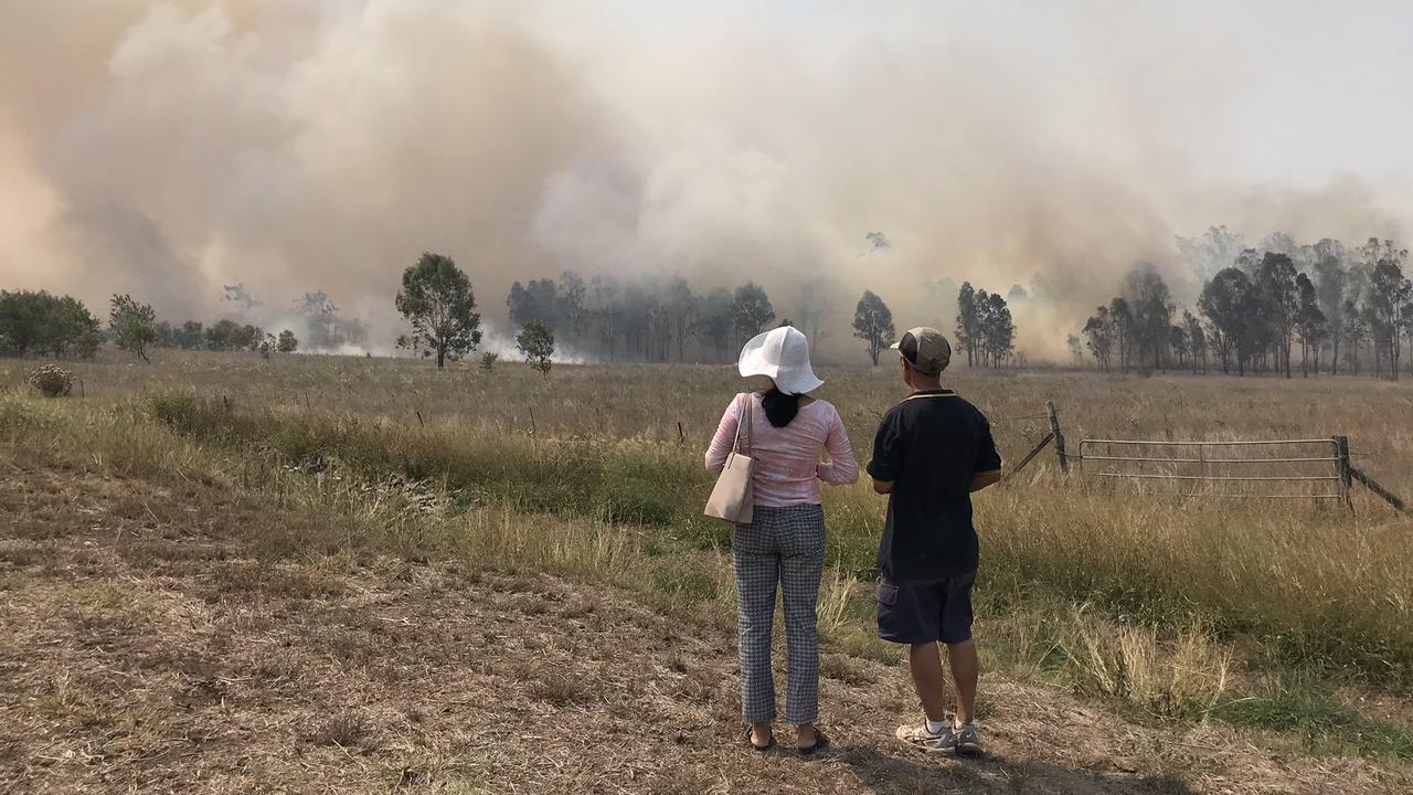A house fire has sparked a fast-moving grass fire near Bundamba.