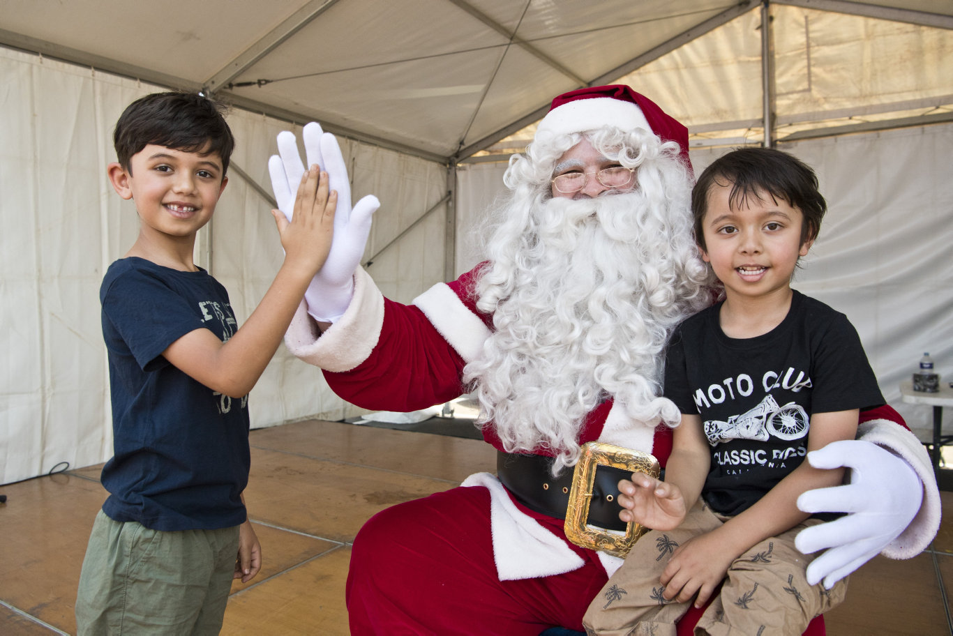 Ibrahim (left) and Yusuf Abawi meet Santa at the Harvey Norman Centre Christmas Party, Saturday, December 7, 2019. Picture: Kevin Farmer