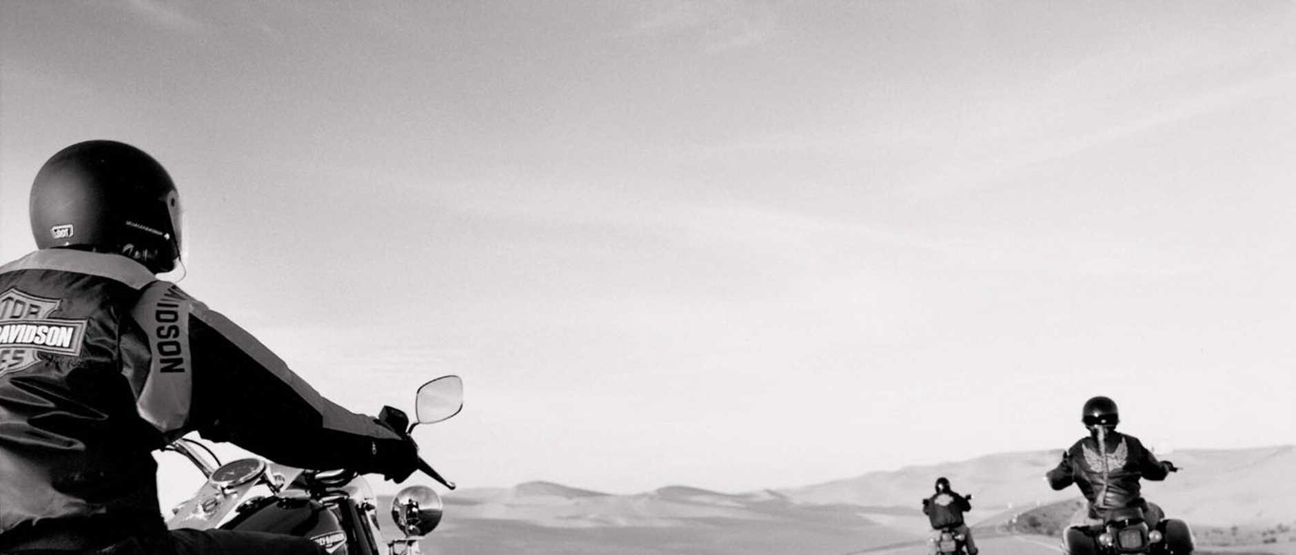 AUGUST, 2003 : Generic photo of men riding Harley Davidson motorcycles down highway, 08/03. Motor Vehicle / Motorcycle / Bike