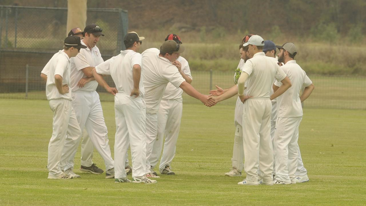 Lawrence celebrate taking a wicket against Harwood at Barry Watts Oval in an LCCA first grade match.
