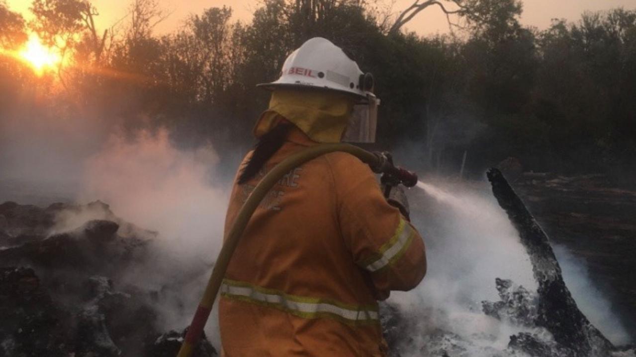 BOOIE BUSHFIRE: Melissa Beil working towards extinguishing the bushfire at Booie, near Kingaroy.