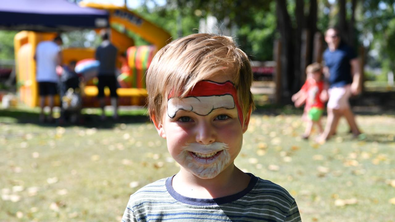 Floyd happy with the results of the face painting at the Apex Santa Fair.