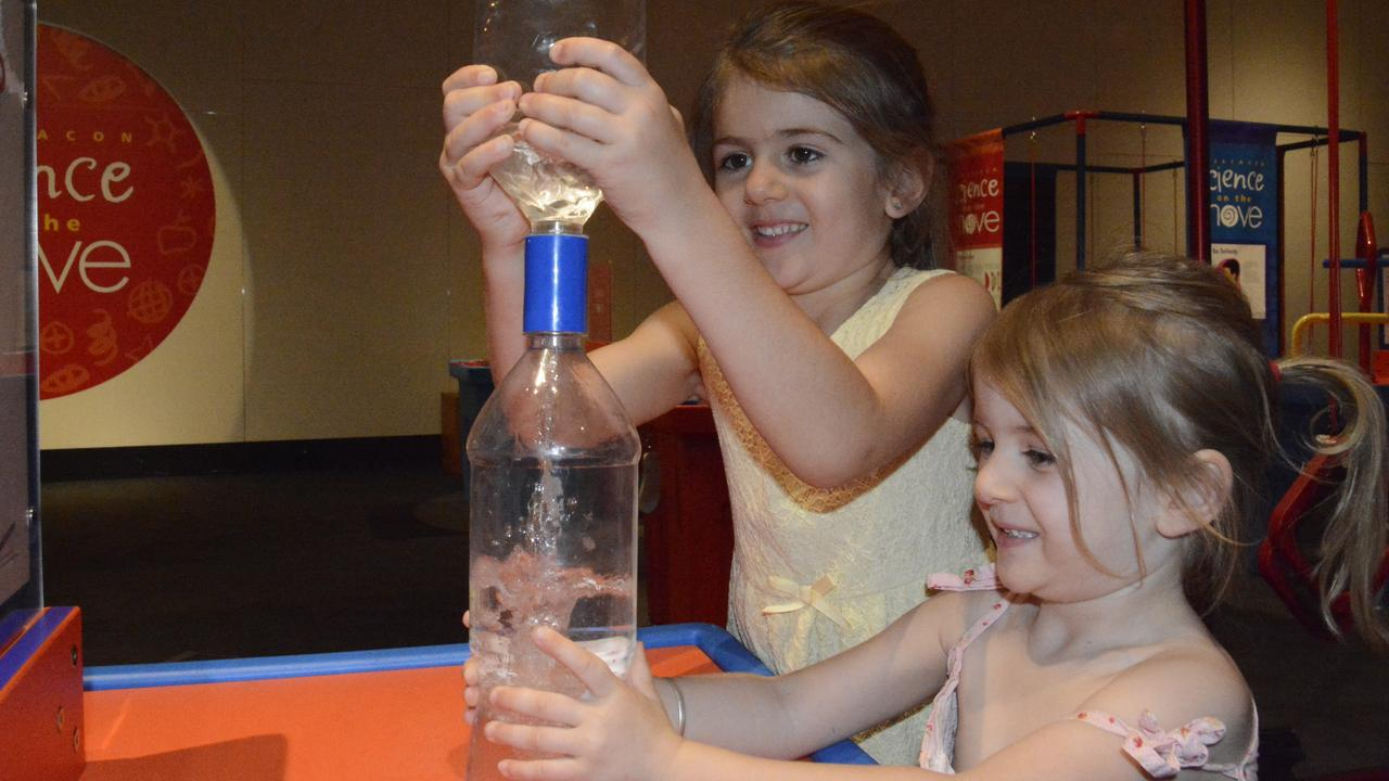 FUN WITH SCIENCE: Toowoomba kids Tallulah and Allegra Sugden check out the wacky activities at Questacon's