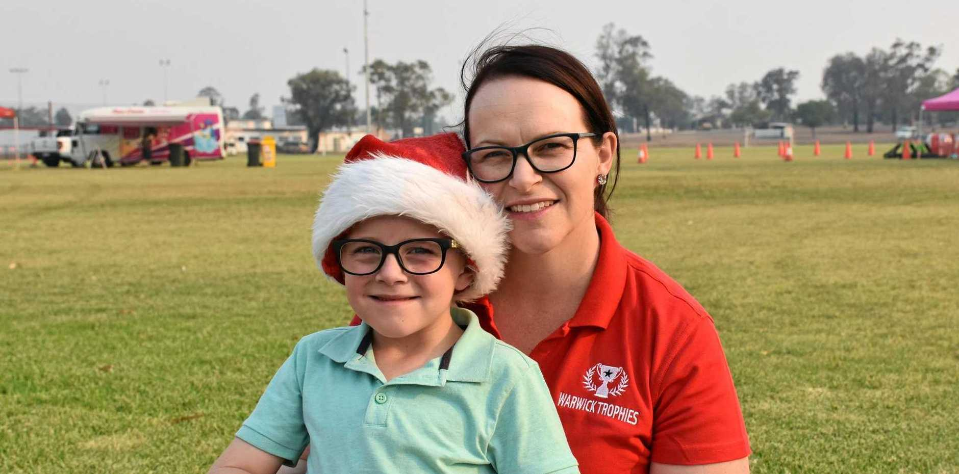 GETTING FESITVE: Angus, 6, and Angela Hamilton at 2019 Carols in the Park.
