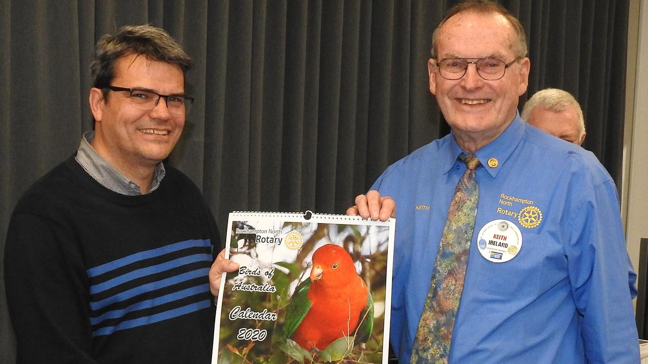 Rockhampton North Rotary Calendar Organiser Keith Ireland (right) presents a 2020 calendar to Genesis Senior Onchology Specialist and Cancer Researcher Dr Fay.