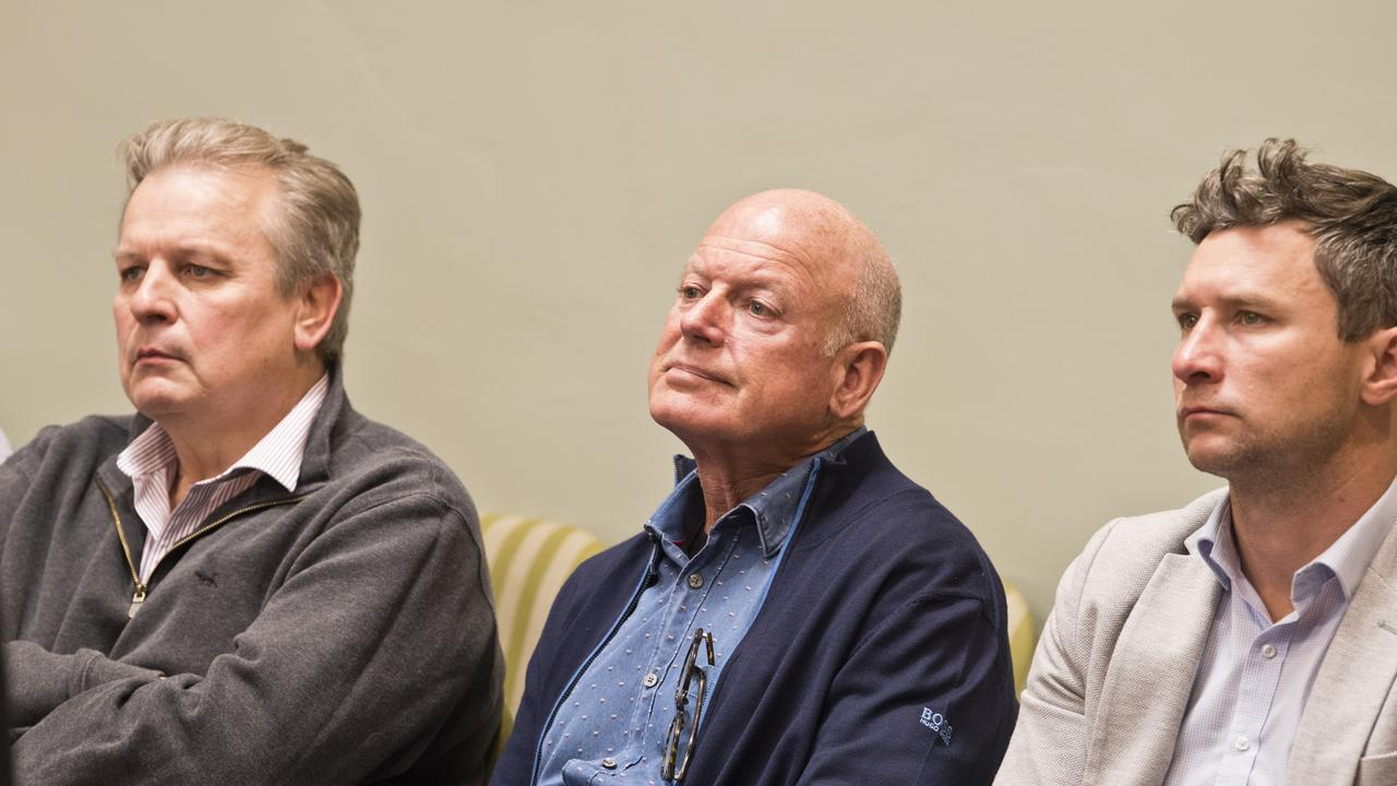 Listening from the public gallery are (from left) Geoff Kath, Ian Knox and Tim Colthup during a special meeting in August of Toowoomba Regional Council to decide the future of the 1500-lot Fernleigh housing estate project at Westbrook.
