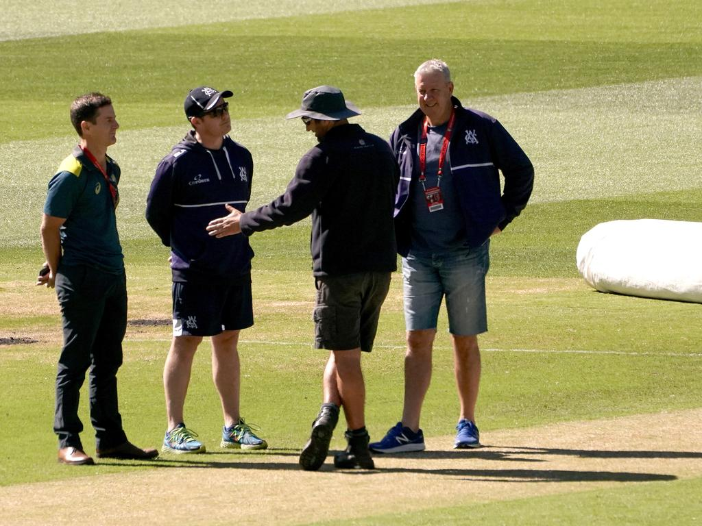 MCG curators discuss the pitch.