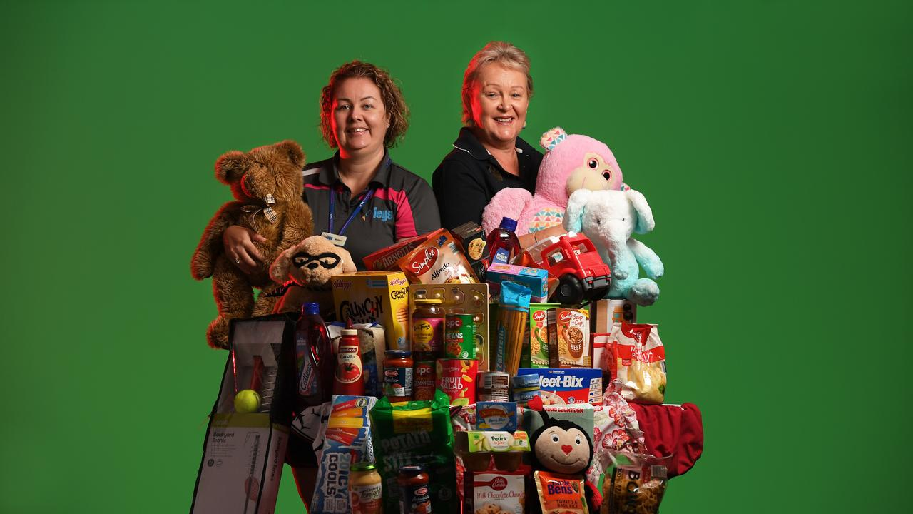 Melissa Pedersen from ICYS and Karen McCoombes from The Queensland Times celebrate the completion of the Adopt a Family Appeal where all 250 families were adopted.