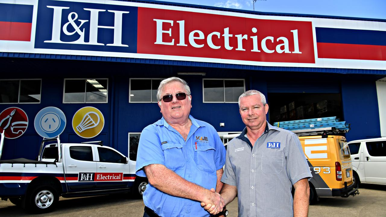 LOYALTY: Past owner of Keith Atkinson Electrical Trevor 'Keith' Atkinson shakes hands with new L & H manager David Guest.