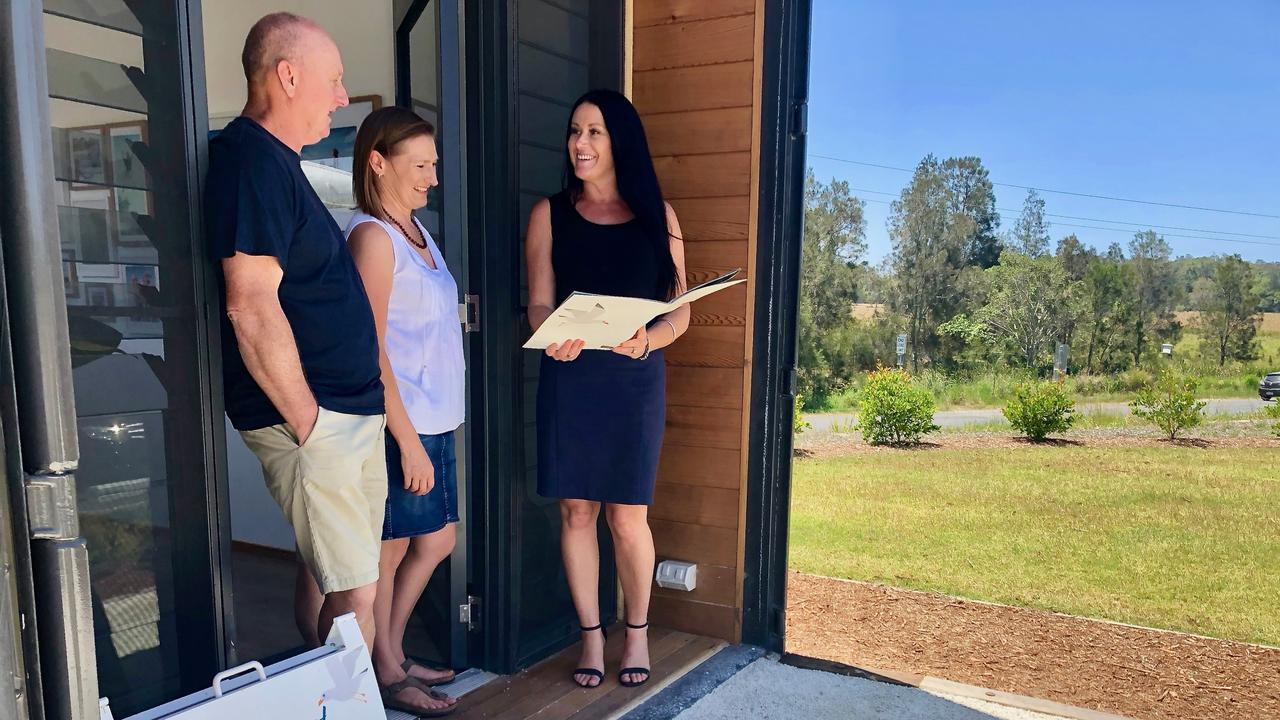 EASY LIVING: Sean and Belinda Buttler with Kingscoast sales agent Rachael Ford. The Cudgen development is proving popular with buyers wanting to be close to the coast and facilities. Picture: SUPPLIED