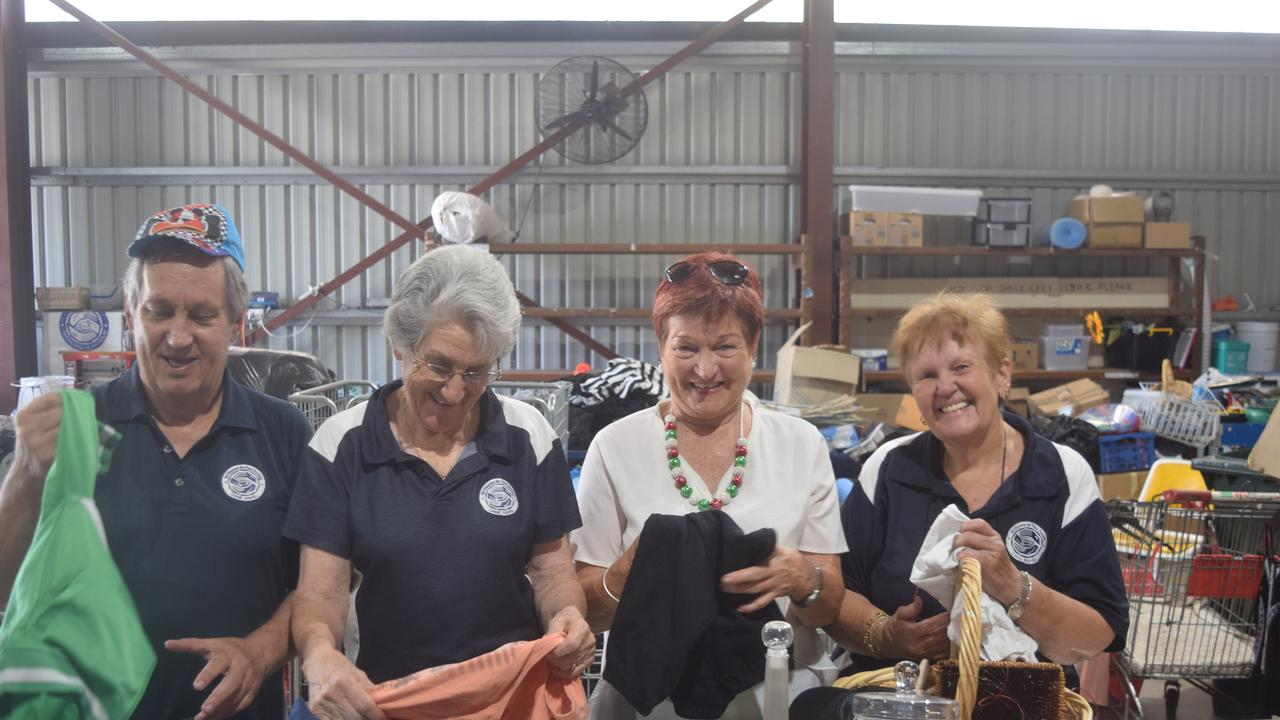 GIVE BACK: Biloela Vinnies volunteers Malcolm, Jenny, Ellena and conference member Gay Fraser sorting through the delivery of the Vinnies Christmas Appeal.