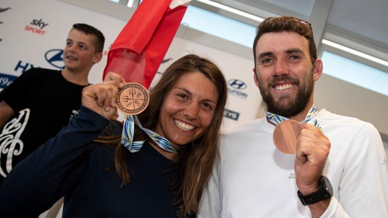 Lisa Darmanin and Jason Waterhouse with their medal.