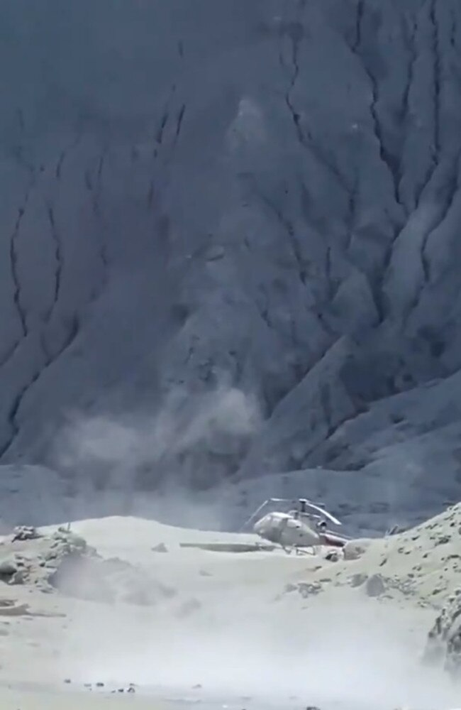 Video shows a helicopter being left behind after the New Zealand White Island volcano eruption Picture: Michael Schade