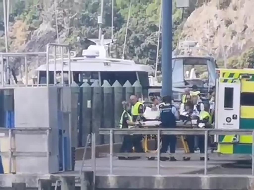 Injured people from White Island Island volcanic explosion are ferried into waiting ambulances at Whakatane Wharf. Picture: New Zealand Herald