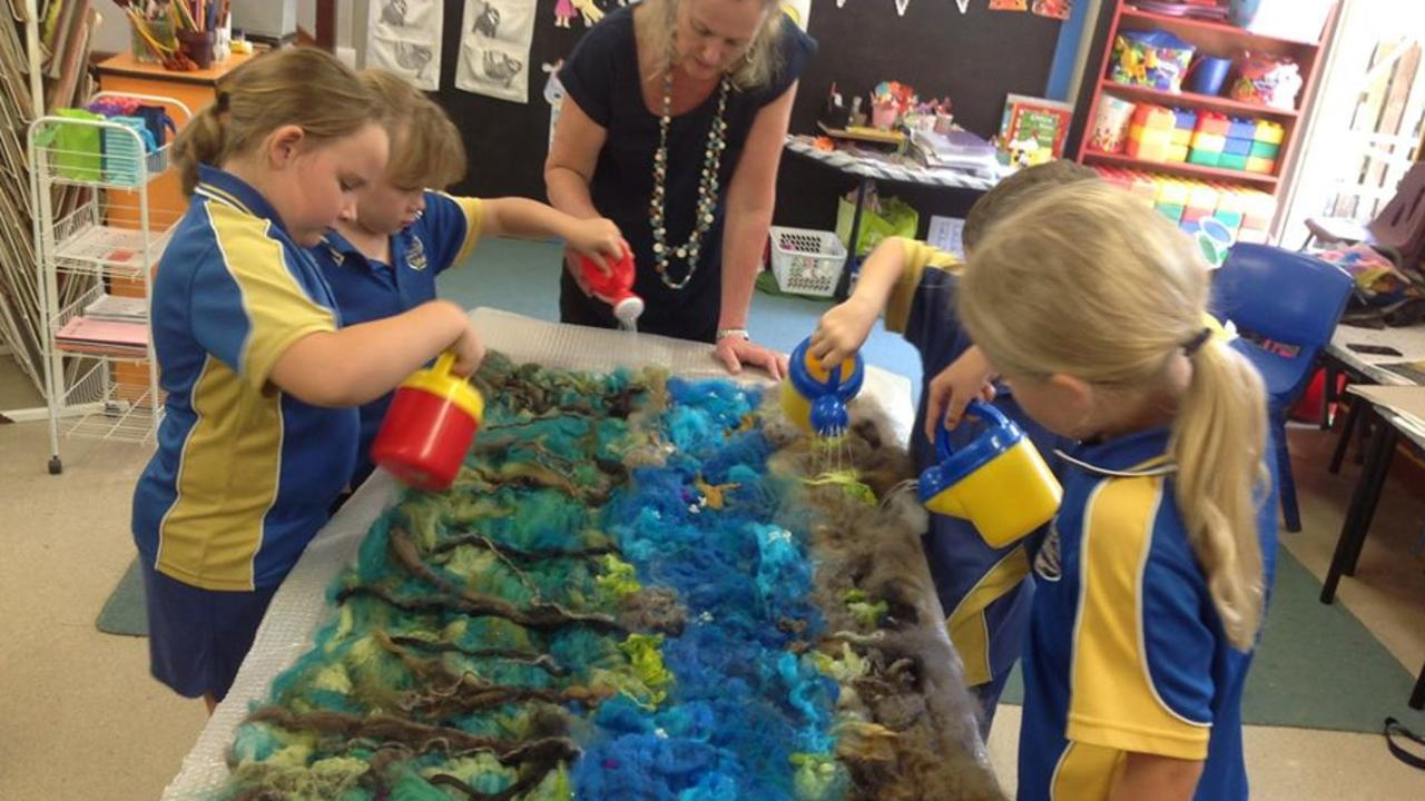 Eungella State School students taking part in a felting project depicting scenes from before and after the 2018 Eungella fires.