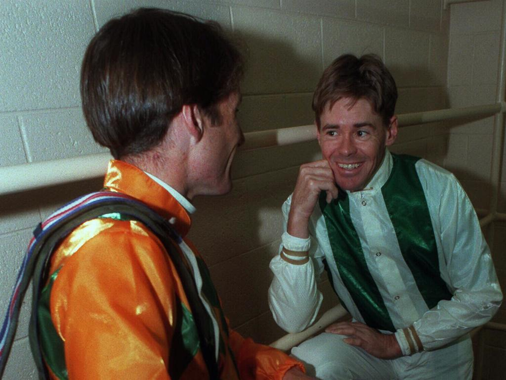 Brent Thomson, talking with Damien Oliver in 1997, has offered to mentor young Queensland jockeys.