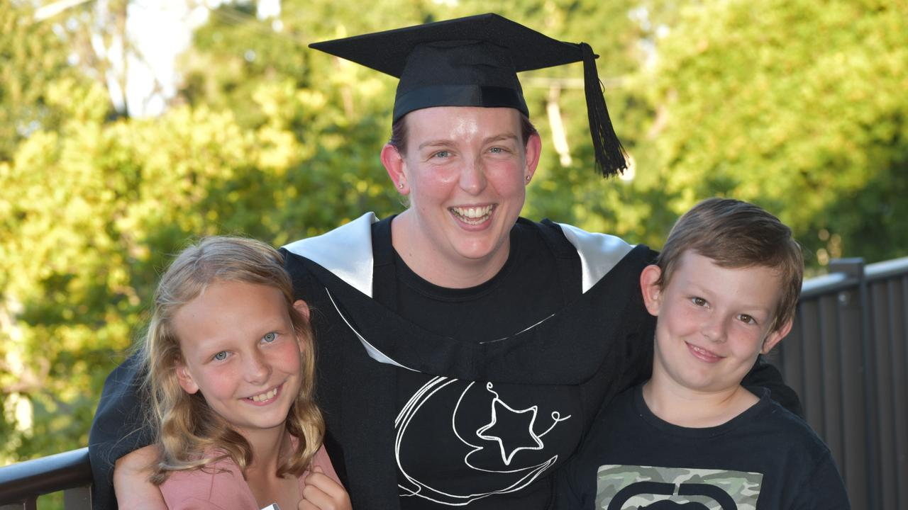 Janine Gillingham celebrates her USC graduation with her children Marcus and Isobel.